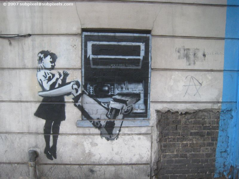 Banksy - ATM with robot arm holding girl